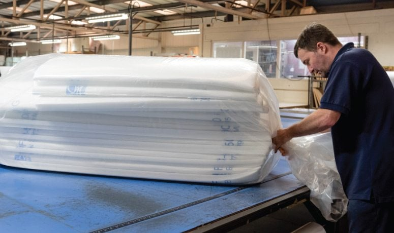 Man packing air filters for the Air Filtration department