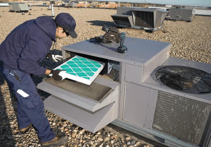 Man installing a HVAC filter