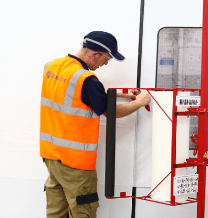 Man in a spray booth carrying out works - Performance and Safety for Spraybooths: Housekeeping