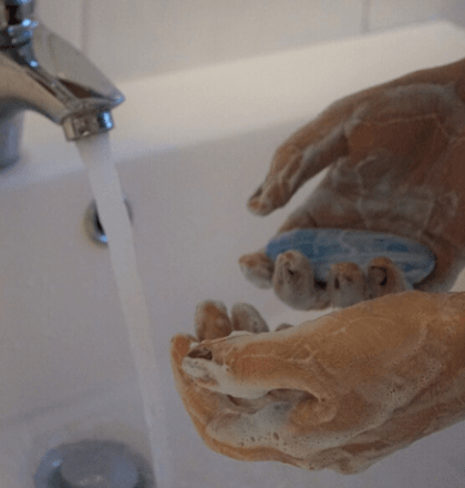 Person cleaning their hands - Returning to Work and Legionella Testing Blog