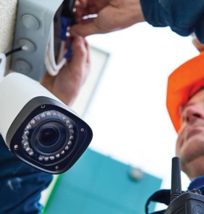 Man installing a CCTV camera - Protect Your Business with a Security System Beta Group