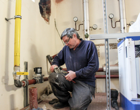 Man carrying out plumbing works - Facilities Maintenance Services Beta Group