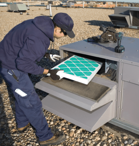Engineer Installs HVAC Air Filter into Air Conditioning Systems