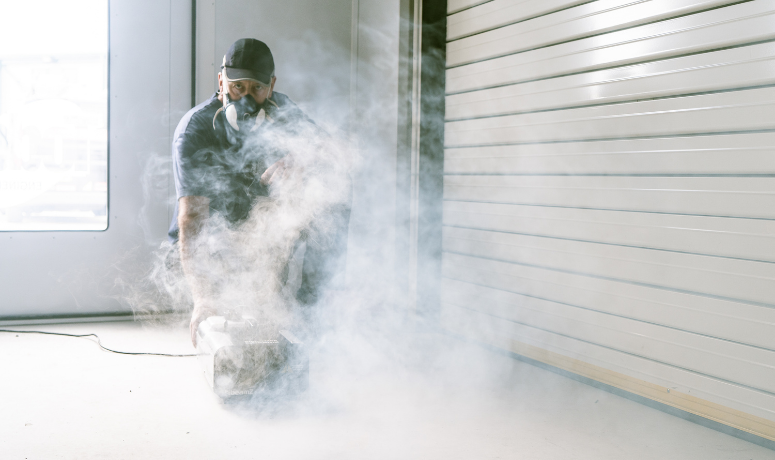 man carrying out part of spray booth service